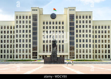 Government House, Minsk, Belarus, including the National Assembly of Belarus, on Independence Square with statue of Lenin - Stock Photo