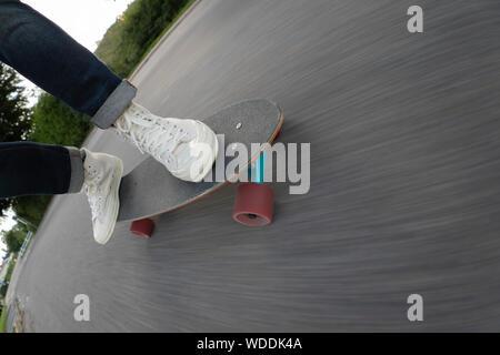 Feet of man skateboarding - Stock Photo