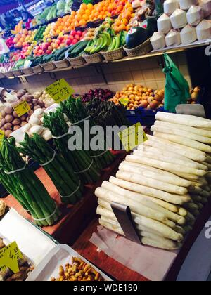 Various Vegetables And Fruits For Sale At Market - Stock Photo