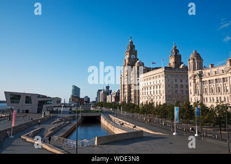 View of Liverpool's famous waterfront buildings on a sunny blue sky day - Stock Photo