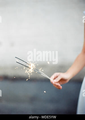 Close-up Of Hand With Sparklers - Stock Photo