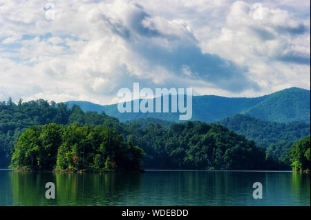 Surreal landscape view of Watauga Lake in eastern Tennessee under cloudy skies. - Stock Photo