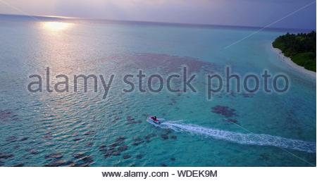 Aerial View Of Man Riding Jet Boat In Sea - Stock Photo