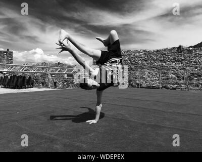 Man Breakdancing On Stage Against Sky - Stock Photo