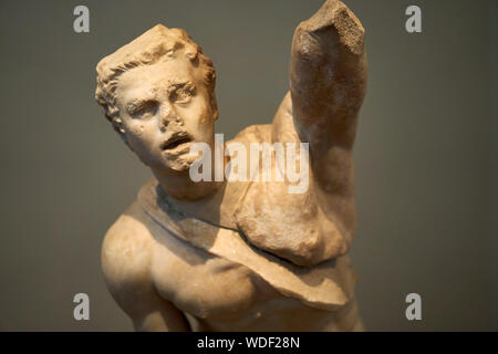 Ancient Greek and Roman sculpture on display at the National Archaeological museum in Athens - Stock Photo