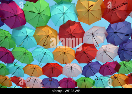 Colourful Parasols or Umbrellas Hanging Above Place Francois Villon, by Artist Patricia Cunha Umbrella Sky Project Art Installation Aix-en-Provence - Stock Photo