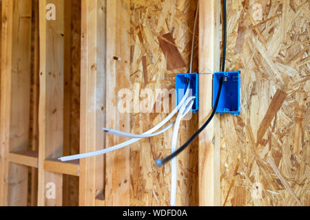 Electrical wiring and CATV cable in walls of new home construction - Stock Photo