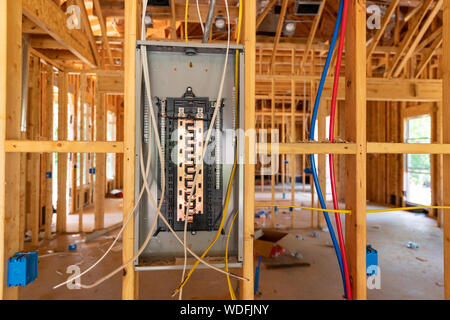 Electrical Circuit Breaker panel in new home construction - Stock Photo
