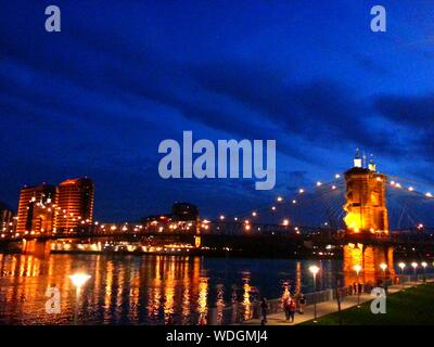 Low Angle View Of John A Roebling Suspension Bridge Over Ohio River At Night - Stock Photo