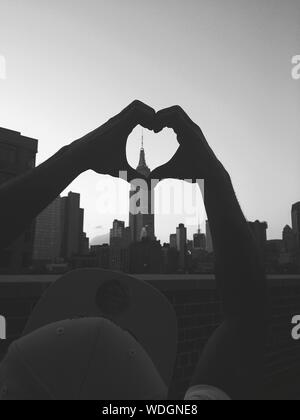 Empire State Building Seen Through Heart Shape Made By Hand - Stock Photo