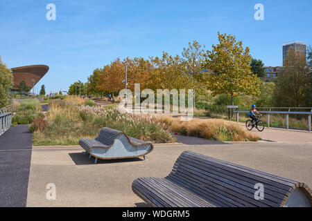 Cycle path and benches near the Velodrome in Queen Elizabeth Olympic Park, Stratford, East London UK - Stock Photo
