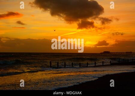 Scenic View Of Beach Against Sky During Sunset - Stock Photo