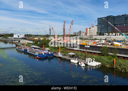 Building works by the Waterworks River, with boats, in the Queen Elizabeth Olympic Park at Stratford, East London UK - Stock Photo