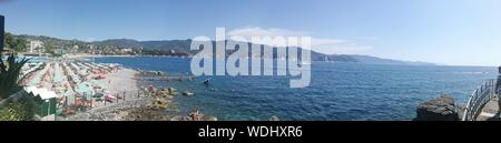 Panoramic View Of Sea Against Blue Sky - Stock Photo