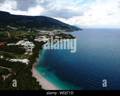 Aerial shot of an empty Zlatni Rat Beach / Golden Horn and the town of Bol, on  Brač Island (Croatia) - Stock Photo