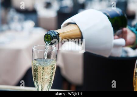 Champagne Being Poured In Glass - Stock Photo