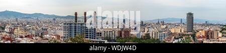 Panoramic view of Barcelona city skyline seen from Montjuic Castle. High resolution wide panorama - Stock Photo
