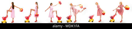 online shopping app. happy shopping girls with full cart. savings on purchases. vintage housewife women going to make payment in supermarket. retro wo - Stock Photo