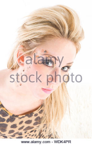 Close-up Portrait Of Beautiful Young Woman Against White Background - Stock Photo