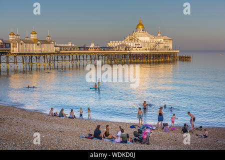 Eastbourne pier and beach in the evening sunshine. Eastbourne, East Sussex UK. - Stock Photo