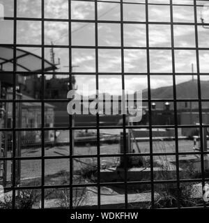 Mountain Against Sky Seen Through Metal Grate - Stock Photo
