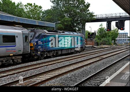 Direct Rail Services Class 68 locomotive 68008 'Avenger'  pulling a Chiltern Railways train at Oxford Railway Station. - Stock Photo