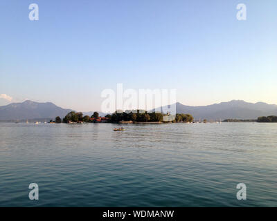 Frauenchiemsee Amidst Lake Against Clear Sky - Stock Photo