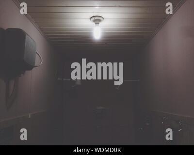 Illuminated Light Bulb In Bathroom At House
