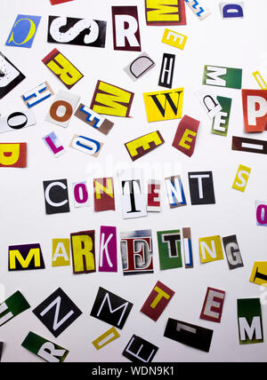 A word writing text showing concept of Content Marketing made of different magazine newspaper letter for Business case on the white background with co - Stock Photo