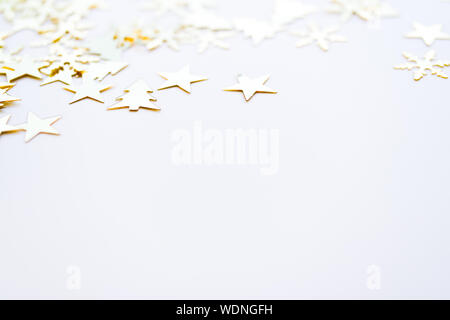 High Angle View Of Golden Christmas Decorations On White Background - Stock Photo