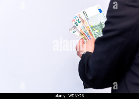 Midsection Of Man Holding Hands Against White Background - Stock Photo