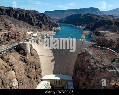 Aerial view of Hoover Dam, Lake Mead, and road leading to dam, a snapshot taken from bypass bridge on the border of Arizona and Nevada, USA. July 2011 - Stock Photo