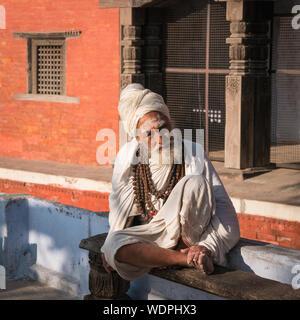 Sadhu Holy Man at Ancient Hindu Nepali Mandir Temple, dedicated to Lord Shiva,  Varanasi, Uttar Pradesh, India, Asia - Stock Photo