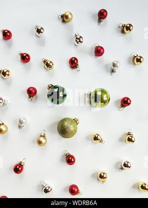 Close Up Of Multi Colored Baubles Over White Background - Stock Photo
