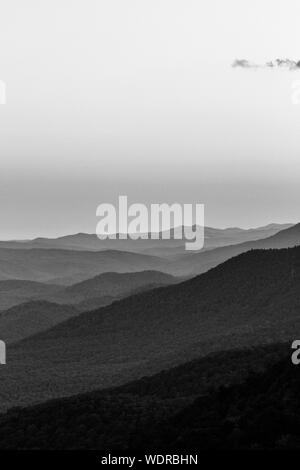 Waves of mountains recede into the distance, viewed from the Pisgah Inn on the Blue Ridge Parkway in Waynesville, NC, USA - Stock Photo