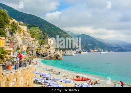 The sea and sandy beach of Spiaggia di Fegina at the Cinque Terre Italy resort village of Monterosso al Mare. - Stock Photo