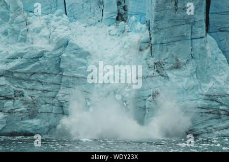 Ice Breaking From A Glacier - Stock Photo