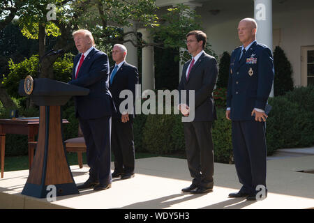President Donald J. Trump hosts a White House ceremony on the establishment of the U.S. Space Command, with Vice President Mike Pence, Secretary of Defense Dr. Mark T. Esper, and the incoming commander of U.S. Space Command, Air Force Gen. John W. Raymond, Washington, D.C., Aug. 29, 2019. (DoD photo by Lisa Ferdinando) - Stock Photo