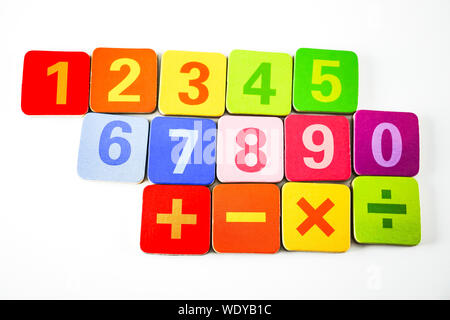 Close-up Of Multi Colored Toys Over White Background - Stock Photo