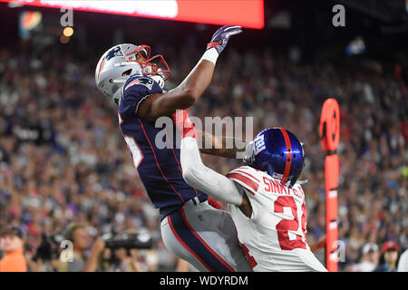 Foxborough, Massachusetts, USA. 29th Aug, 2019. August 29, 2019: New York Giants defensive back Terrell Sinkfield Jr. (24) covers New England Patriots wide receiver Jakobi Meyers (16) during the pre-season NFL game between the New York Giants and the New England Patriots held at Gillette Stadium in Foxborough Massachusetts. The Giants defeat the Patriots 31-29 in regulation time. Eric Canha/CSM Credit: Cal Sport Media/Alamy Live News - Stock Photo