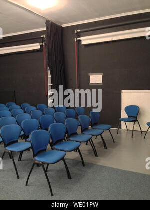 Rows Of Blue Chairs In An Empty Conference Room - Stock Photo