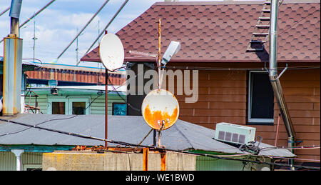 Satellite dish on the roof of the building. Technology. - Stock Photo