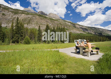 father and kids having a picnic - rocky mountains, canada - adobe RGB - Stock Photo