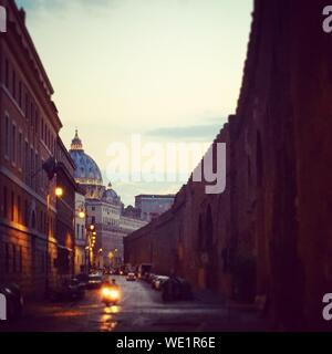 Empty Road Along Built Structures - Stock Photo