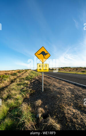 An iconic kangaroo road sign against a blue sky on the Great Ocean Road in Victoria, Australia - Stock Photo