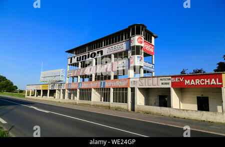 The old motor racing circuit at Gueux near Reims in Champagne, France.  Track and abandoned stands. - Stock Photo
