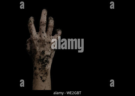 The hands of the zombies emerge from the grave isolated on black background. - Stock Photo
