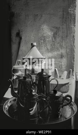 Teapots On Plate Against Wall - Stock Photo