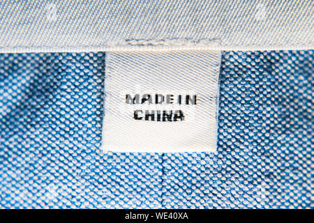 'Made in China' on clothes label - Stock Photo