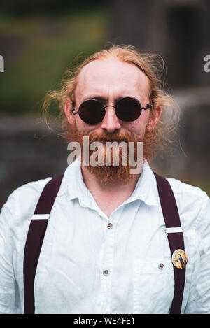 Blaenavon, Wales,  United Kingdom, July, 14, 2019. Blaenavon Ironworks  Steampunk Festival. People having fun and dressed in  steampunk outfits. - Stock Photo